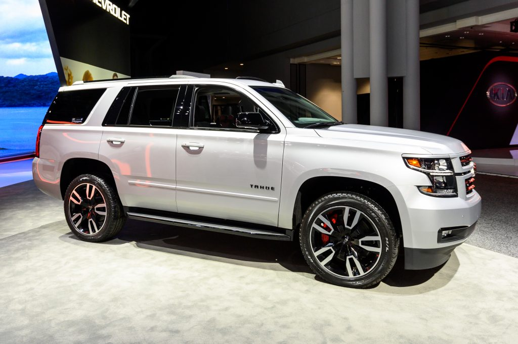 A white Chevrolet Tahoe on display indoors at an auto show.