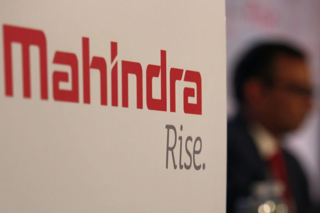 The Mahindra Rise. slogan on a white wall at a convention
