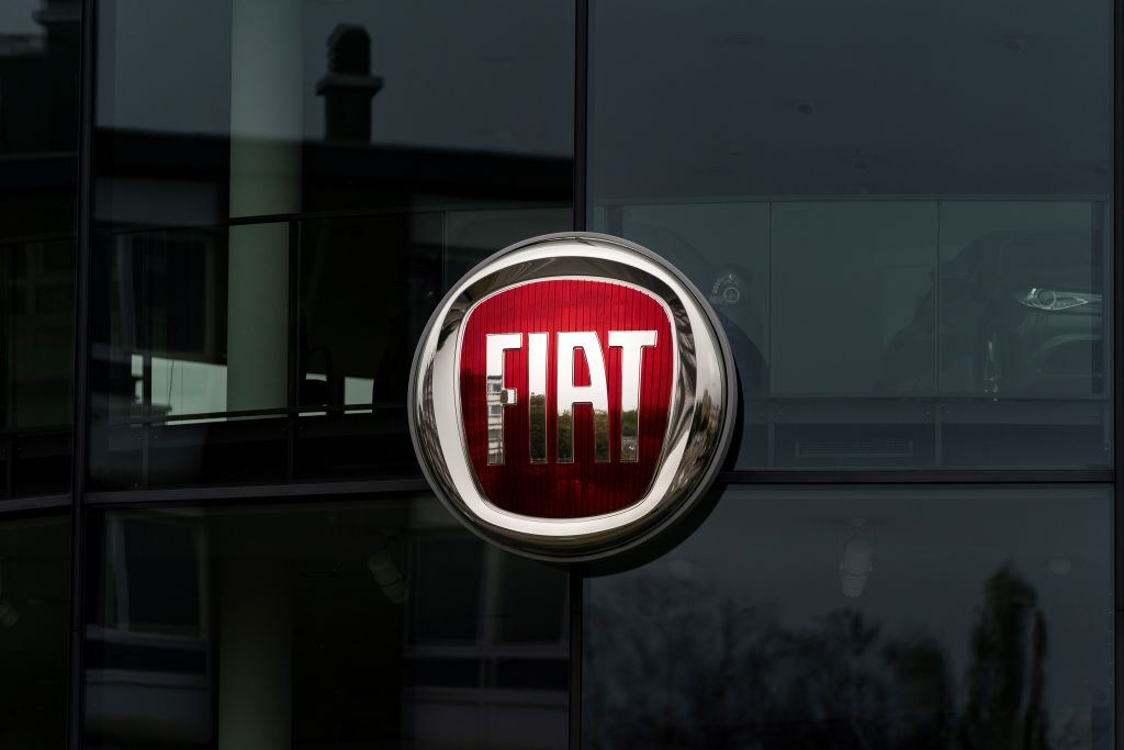 The red and silver Fiat logo on a glass building