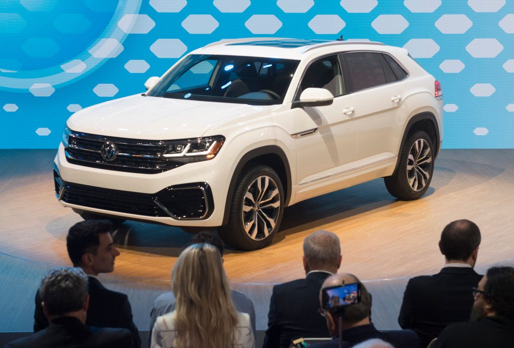 a white 2020 Volkswagen Atlas on display at an auto show