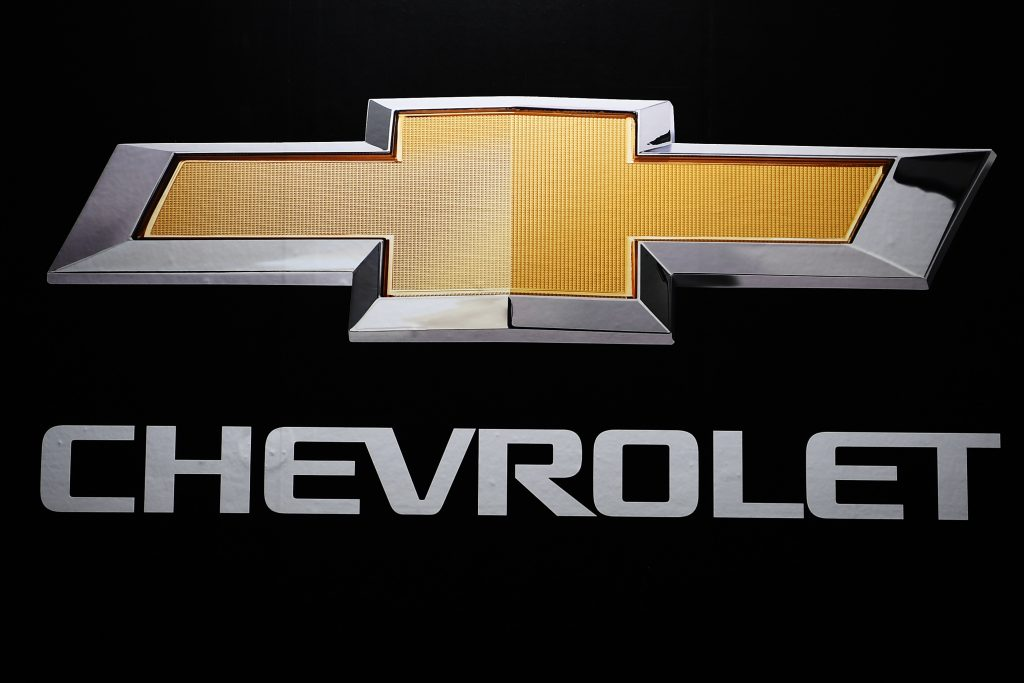 The gold Chevrolet logo and text on a black background