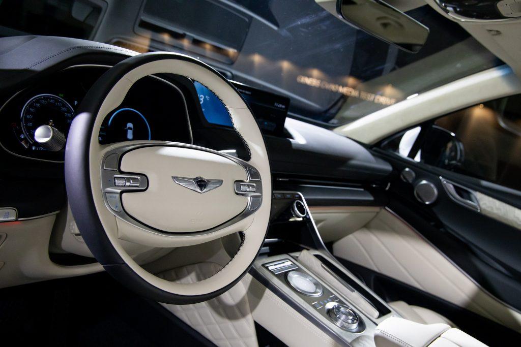 The cream colored interior of the GV80