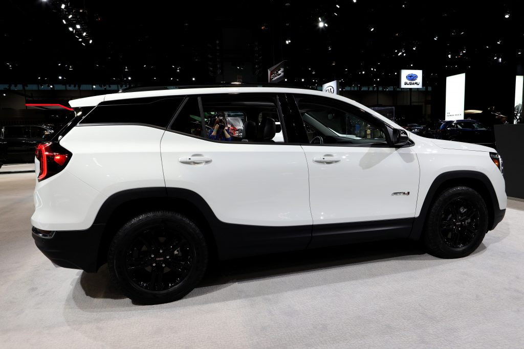 The 2021 GMC Terrain in white, photographed in profile
