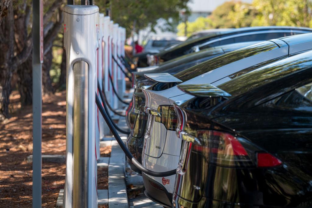 A row of Teslas charging in California
