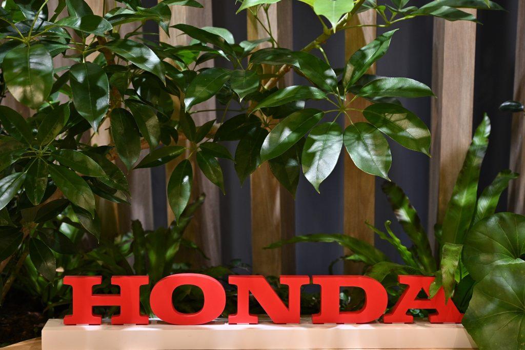 Honda's logo among plants in an office