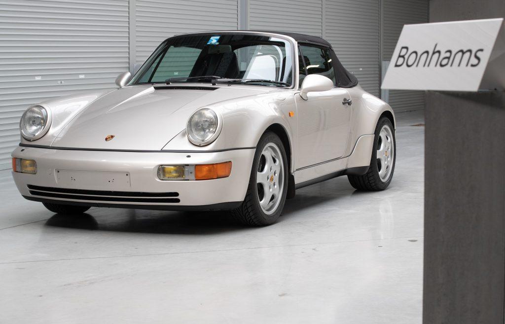 A silver Porsche convertible at auction at Bonham's