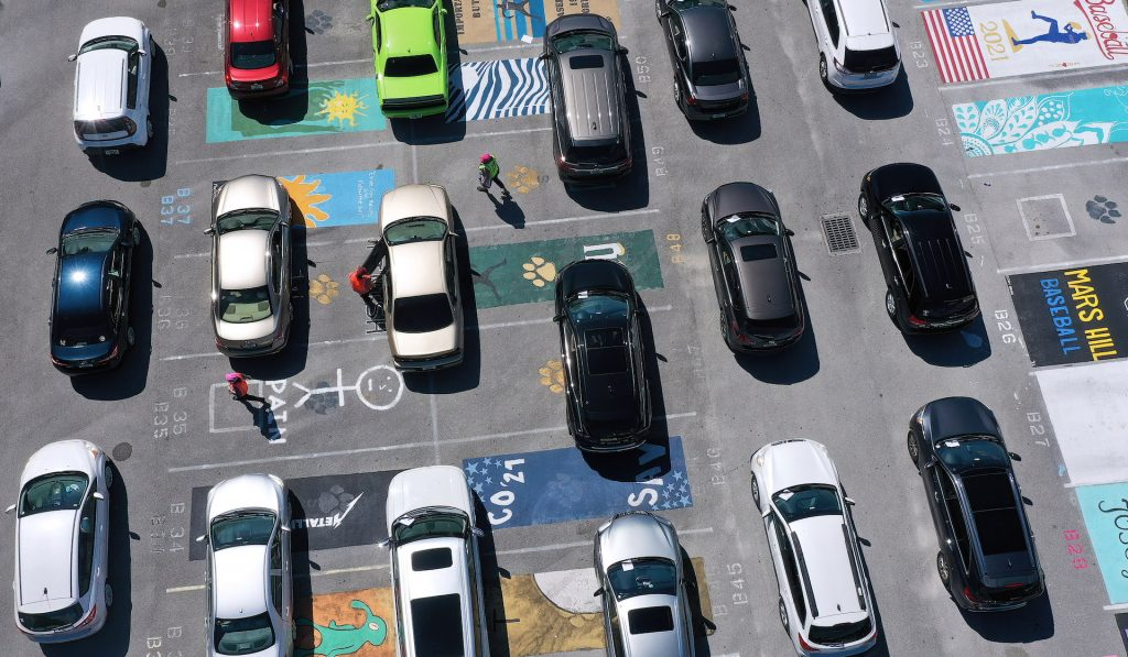 An image of several vehicles parked on their own separate parking spot.