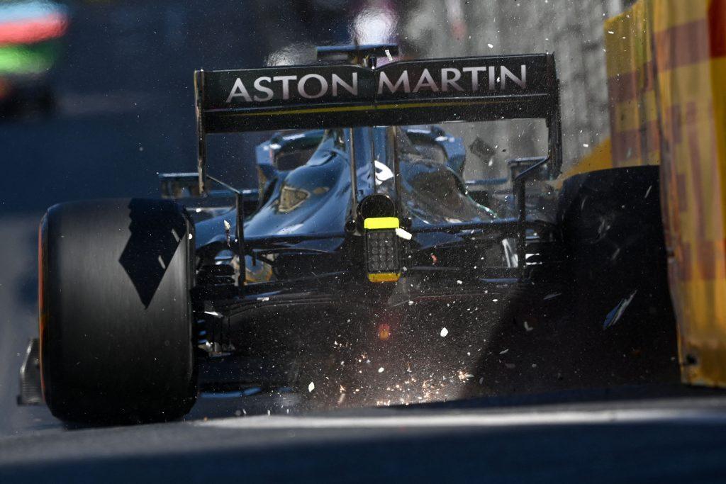 Lance Stroll's Aston Martin mid-crash after his Pirelli tires failed