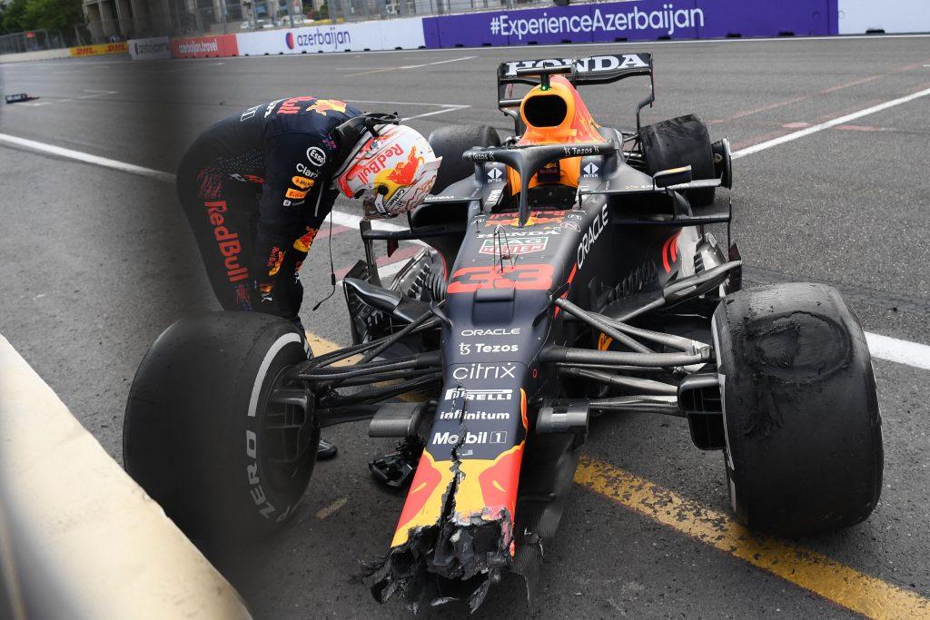 Verstappen hangs his head at his broken Pirelli-shod F1 car