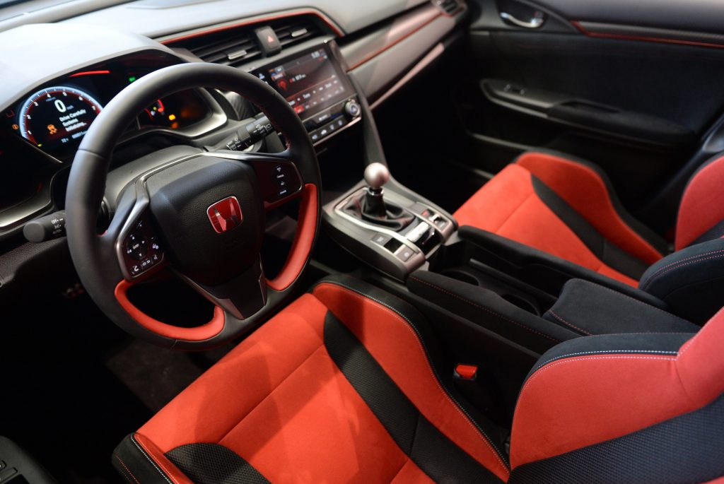 The red and black alcantara interior of the Honda Civic Type R