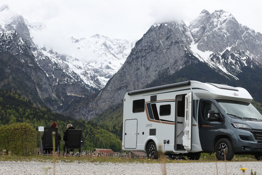 a motorhome camper parked near a stunning mountain view