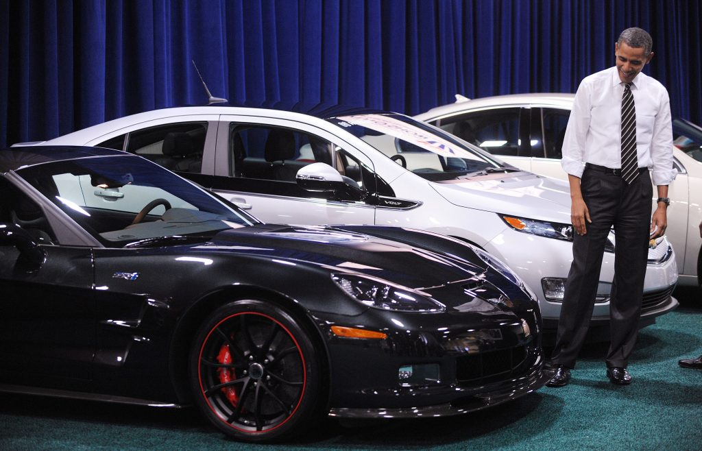 President Obama smiles, admiring a C6 ZR1 Corvette