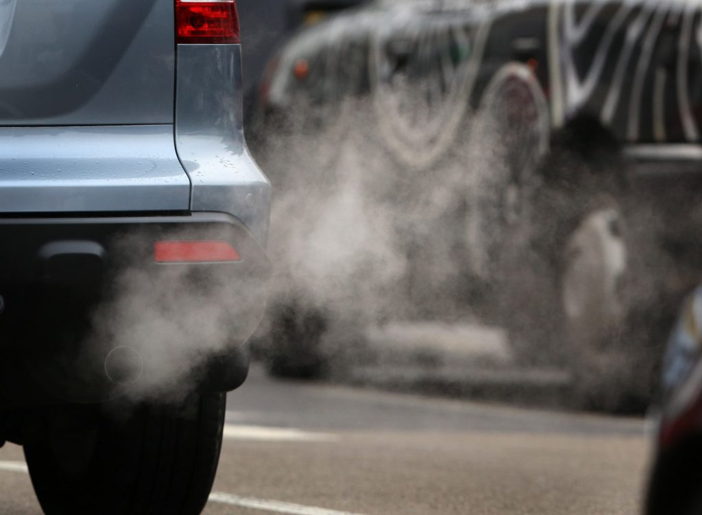 Tailpipe emissions from a vehicle are visible on a cold morning