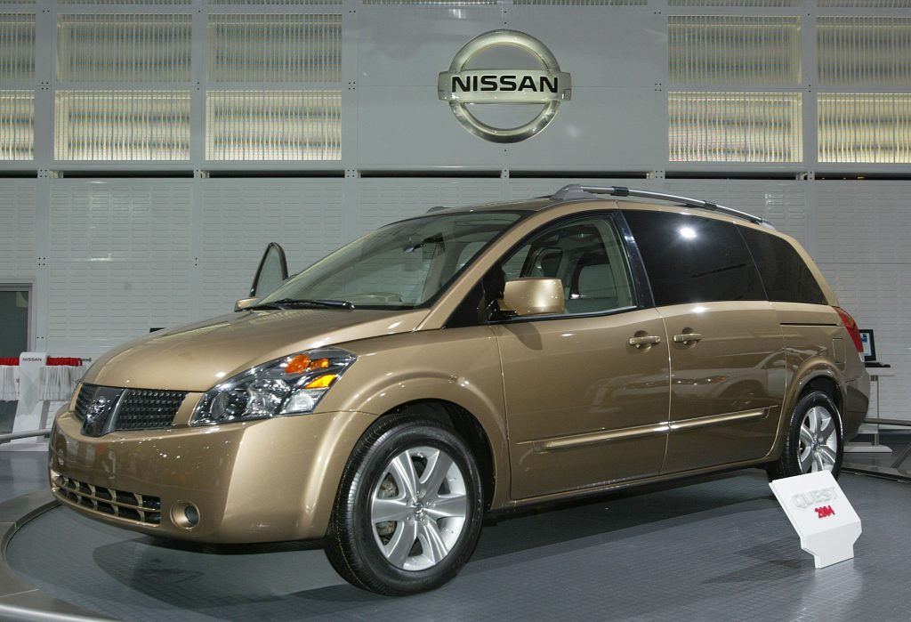 a gold 2003 Nissan Quest on display at an auto show