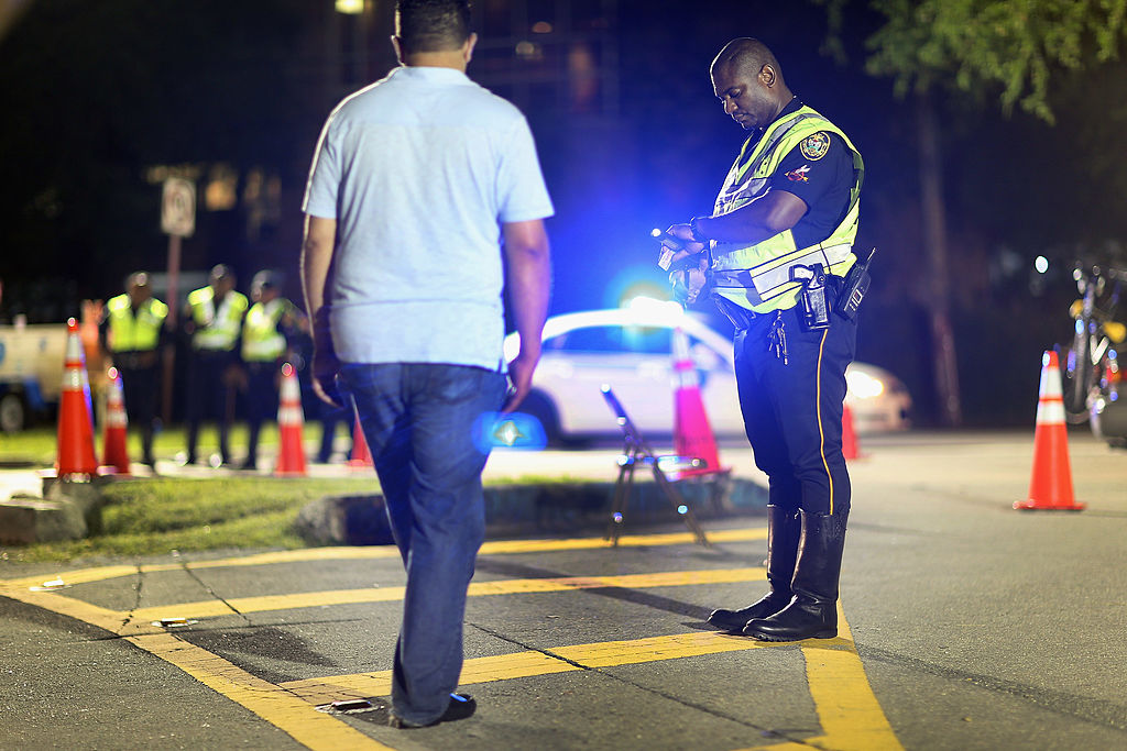 a cop at a DUI checkpoint performing tests