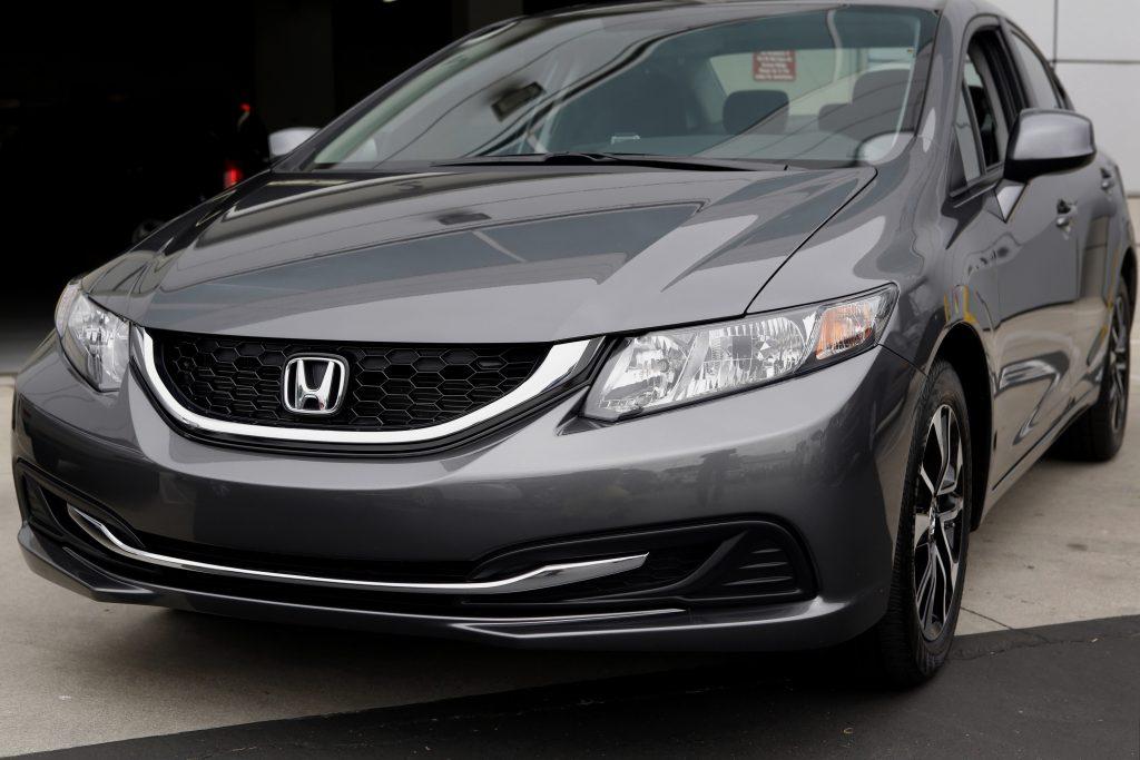 A grey Honda Civic parked streetside