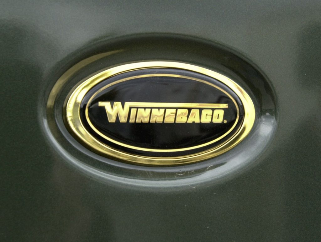 a winnebago logo on a dark greenish gray winnebago model