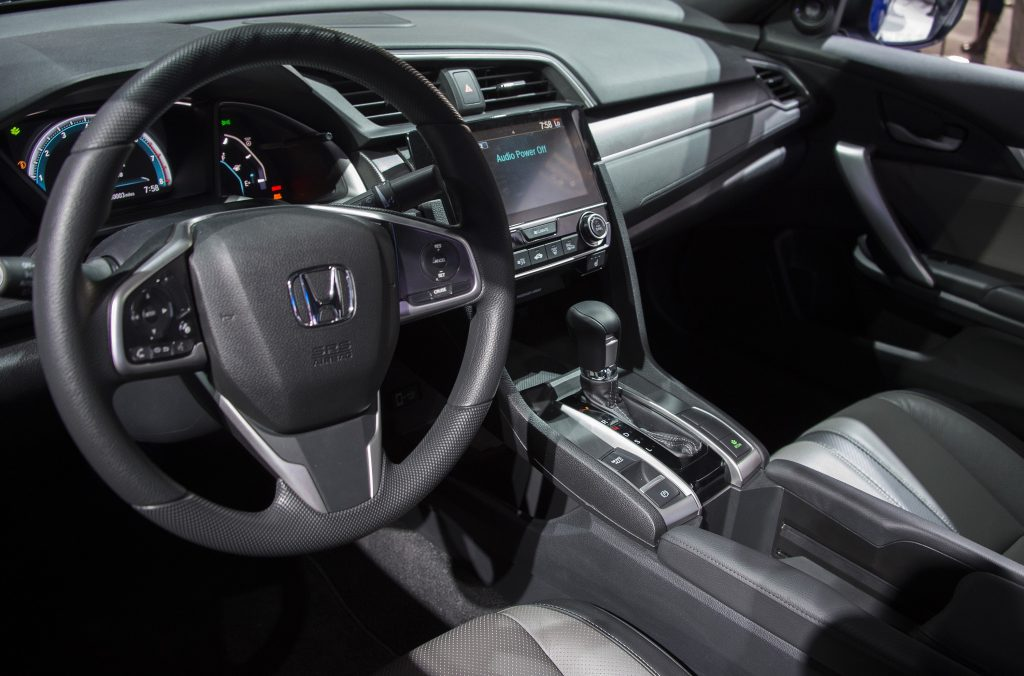 The black-on-black interior of a Honda Civic