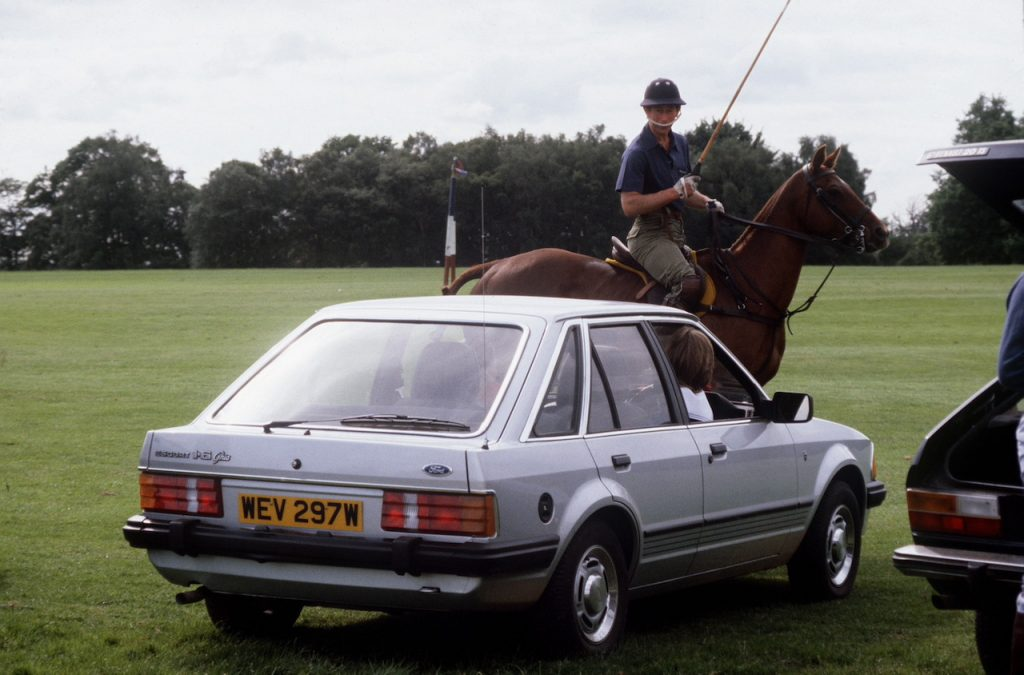 An image of Princess Diana driving her Ford Escort.