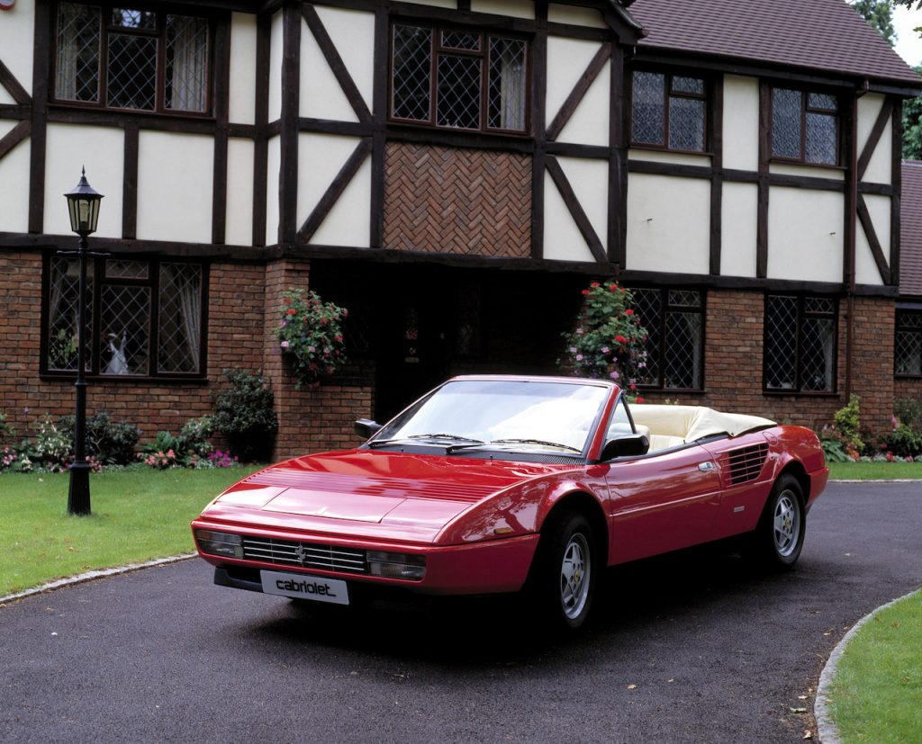 An image of a Ferrari Mondial parked in a driveway.