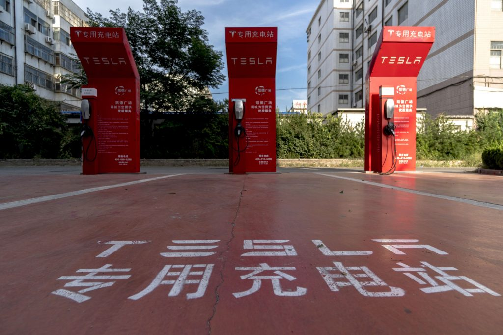 Red Tesla charging stations on a street in China