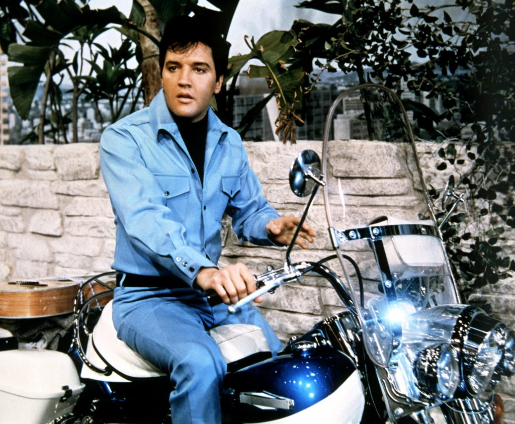 Elvis Presely sitting on a different Harley