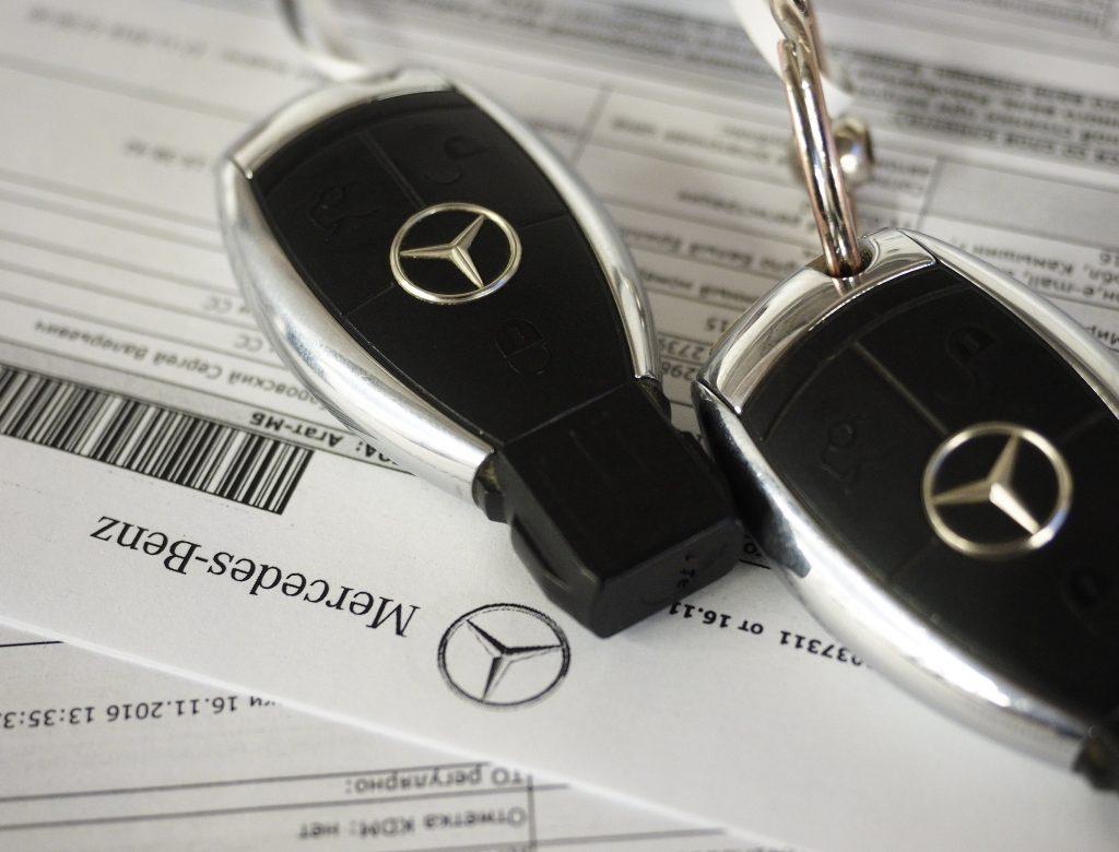 A pair of early keyless entry Mercedes-Benz keys