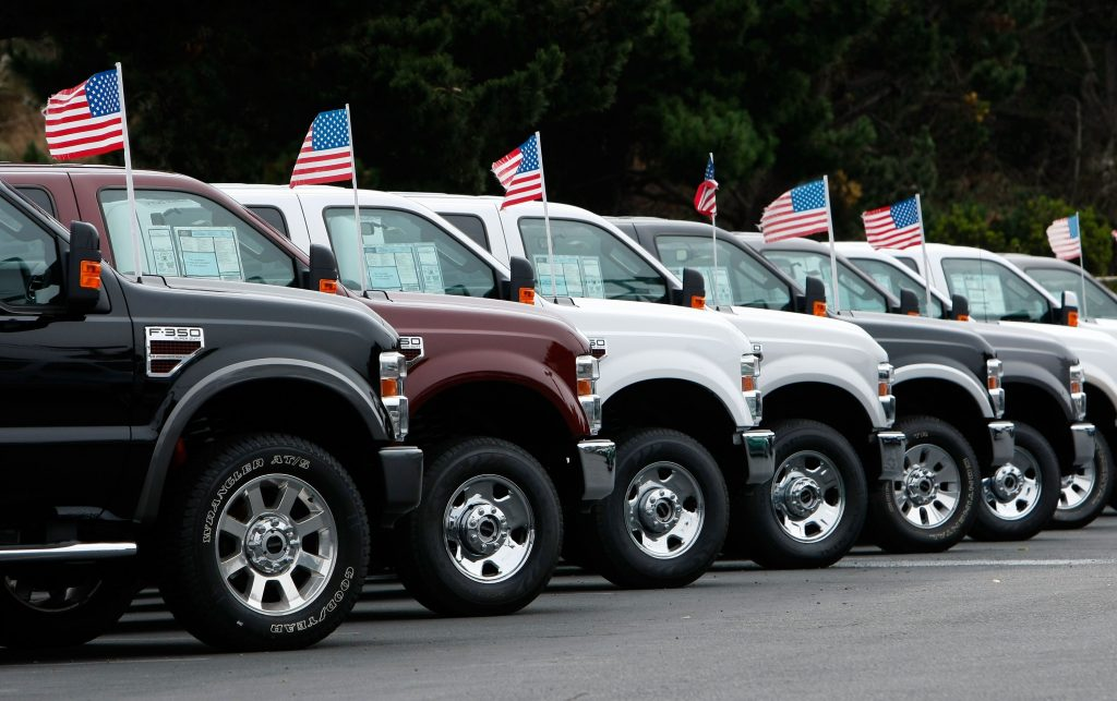 A line of Ford pickup trucks. Someone will surely take a car loan on one