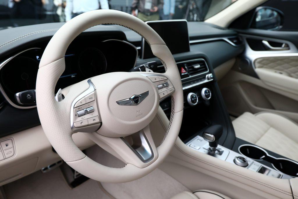 The cream-colored interior of the Genesis G70