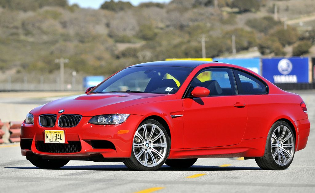 A red 2008 BMW M3 on a racetrack in California