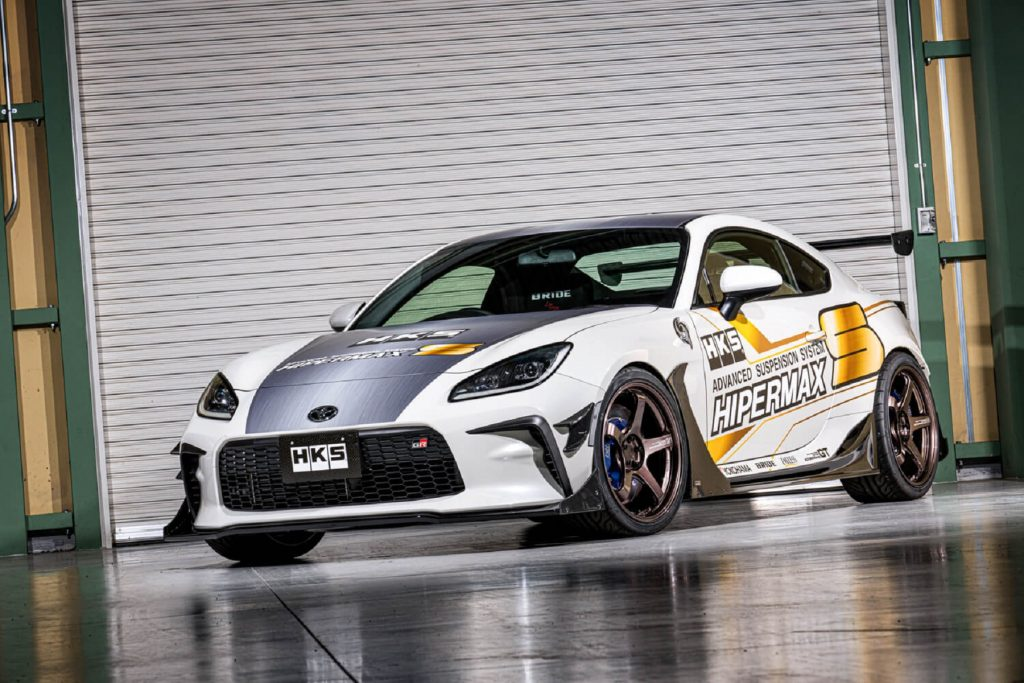 The white-and-gold HKS Toyota GR 86 Concept in a garage