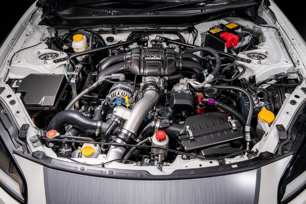 The engine bay of the HKS Toyota GR 86 Concept showing the supercharger kit