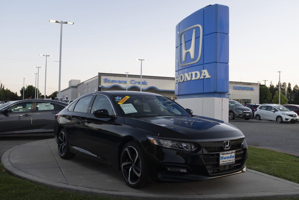 Honda logo and black Honda Accord vehicle are seen at a store in San Jose, California on August 27, 2019.