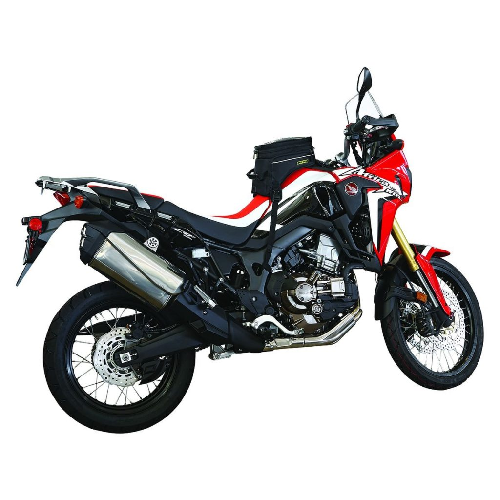 A red-and-white Honda Africa Twin with a black Nelson Rigg Trails End Adventure motorcycle tank bag