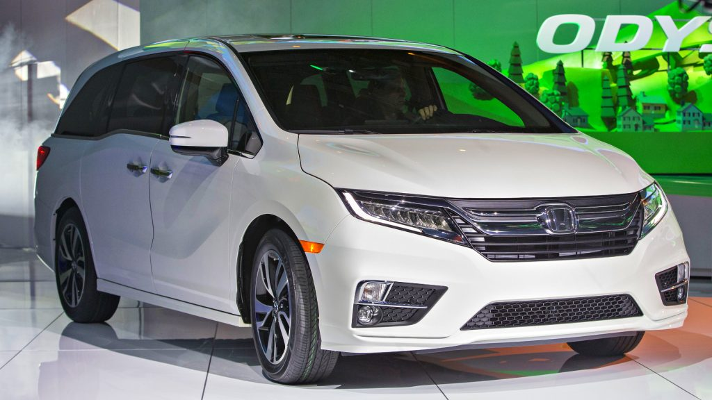 A white Honda Odyssey minivan vehicle sits on display during the 2017 North American International Auto Show.