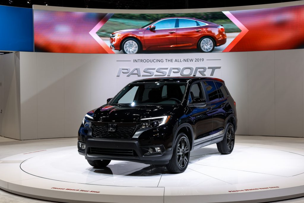A black Honda Passport AWD Sport is on display at the Chicago Auto Show.