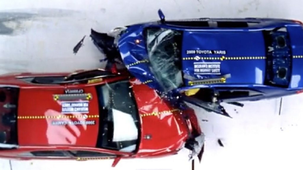 The front left corners of a red car and a blue car collide.