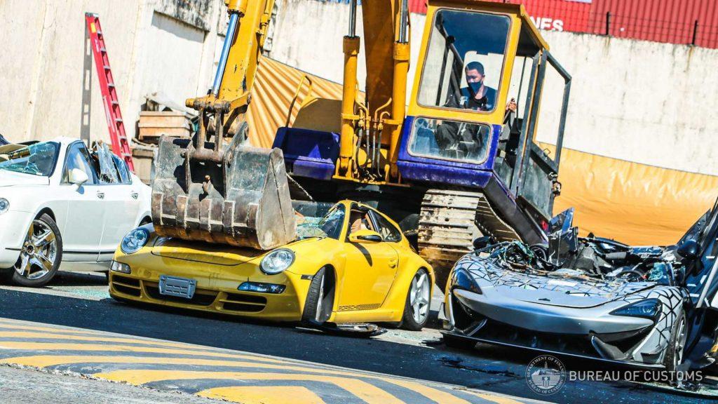 Illegal Philippines Porsche smashed