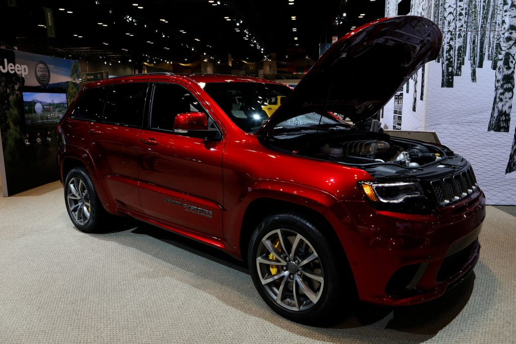A red Jeep Grand Cherokee Trackhawk SUV