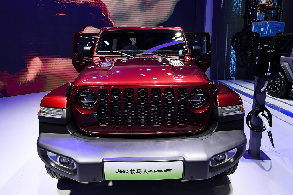 A red Jeep Motor Wrangler 4xe car is on displayed during the 19th Shanghai International Automobile Industry Exhibition