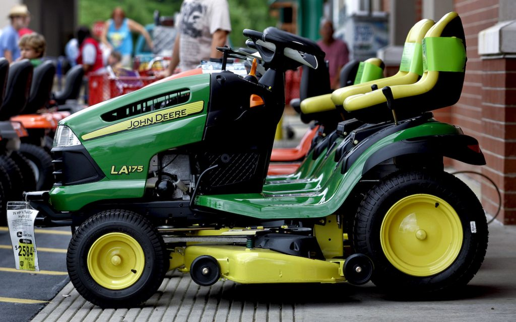 A John Deere riding lawn mower on display, John Deere is one of the best lawn mower brands