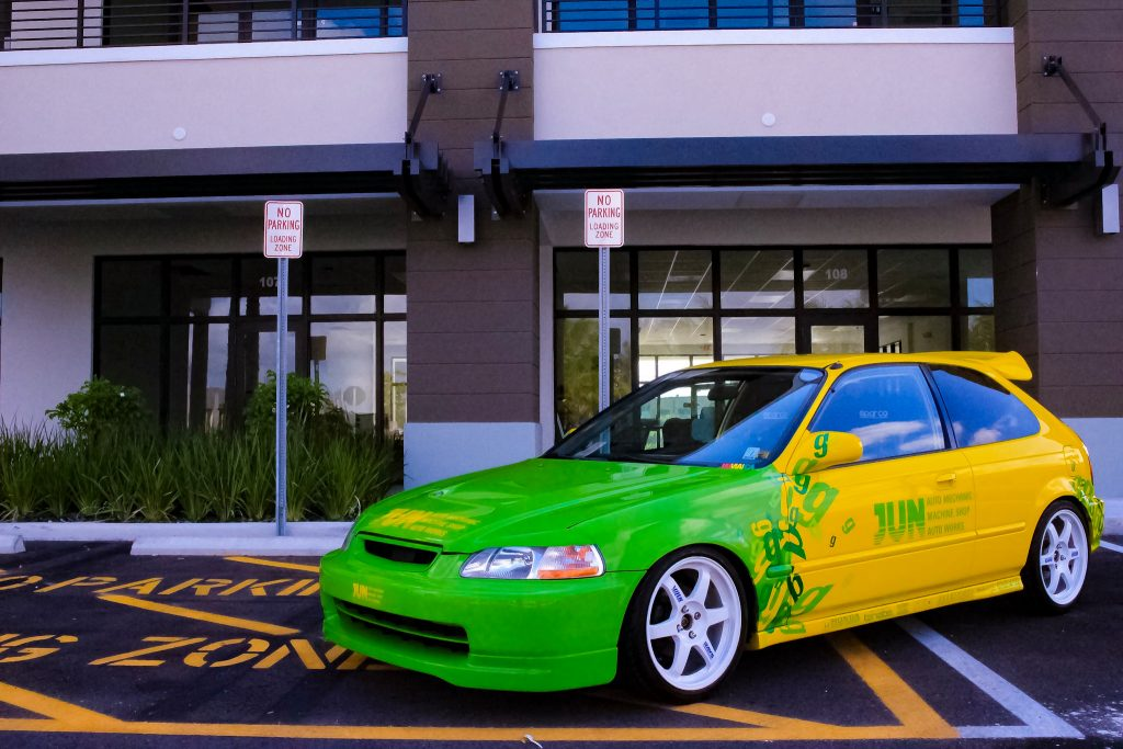 a front shot of the The Jun Auto Civic  in a parking lot