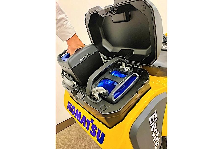 Komatsu electric excavator showing the Honda battery pack