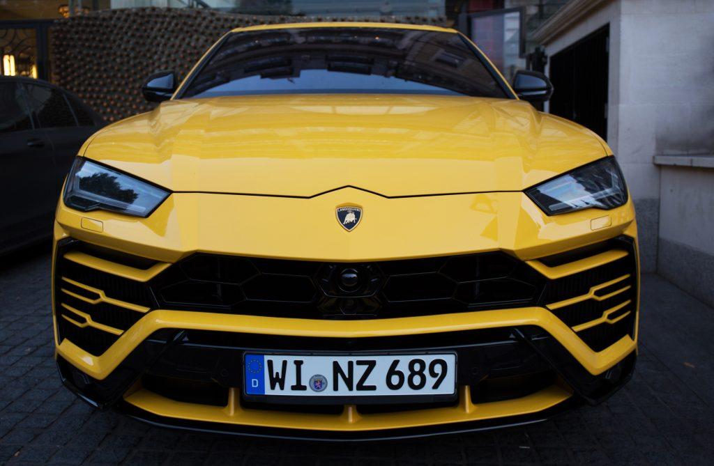 A yellow Lamborghini Urus