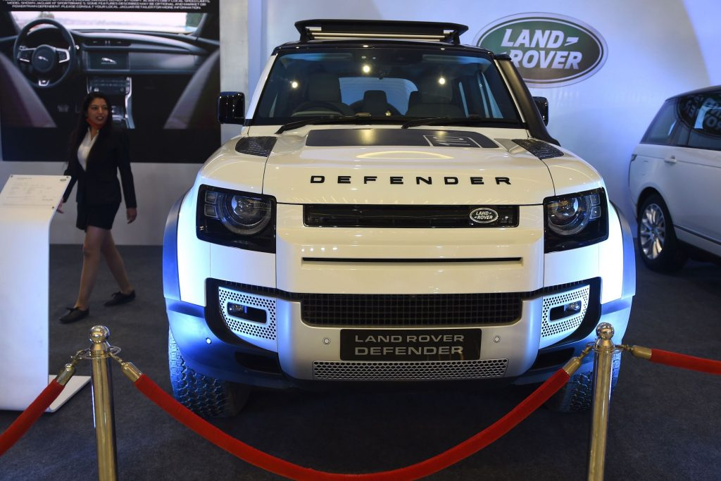 White Land Rover 'Defender' is seen on display during the first day of a two-day-long 'Auto de Glam Expo' on the outskirts of Ahmedabad