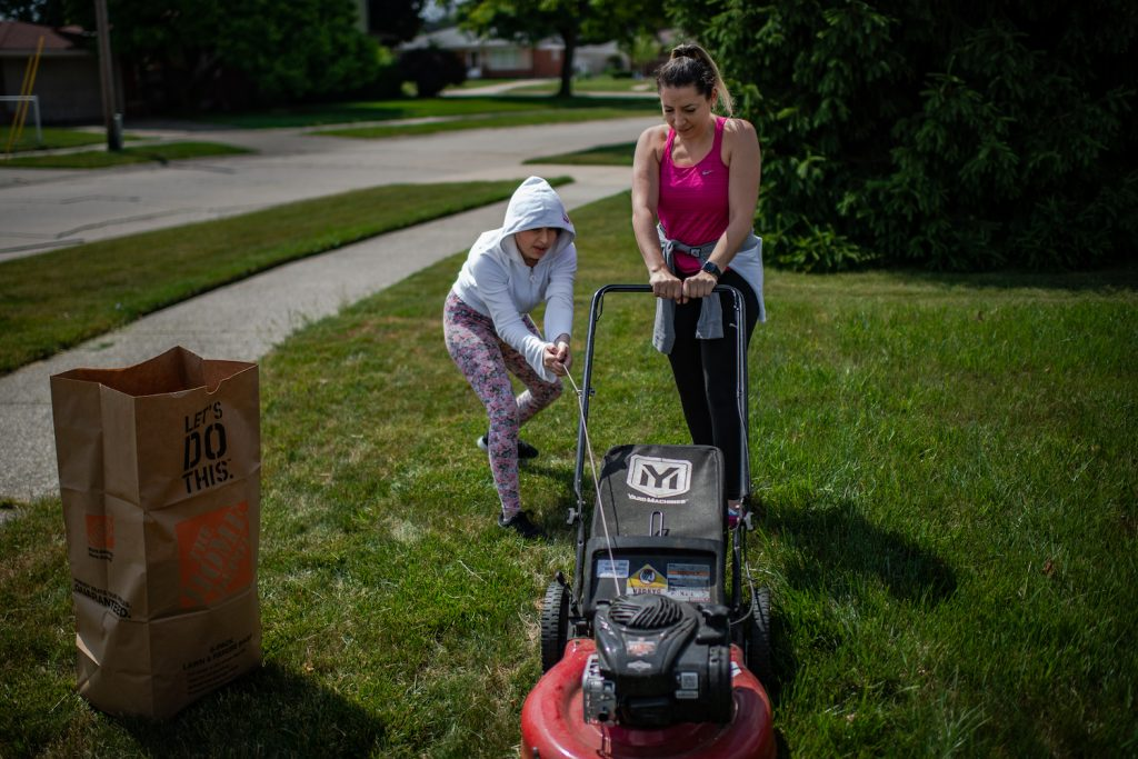 Two people trying to start a lawn mower, if your lawn mower won't start, there's likely a reason why