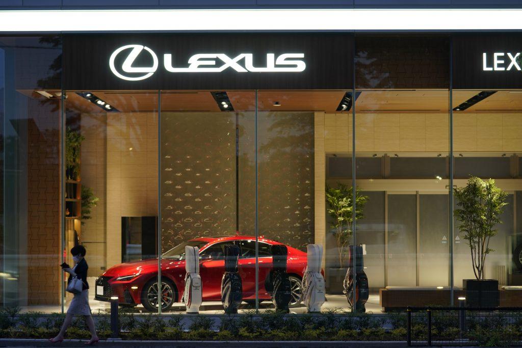 A red Toyota Motor Corp. Lexus IS300 sedan at a Lexus dealership in Tokyo, Japan