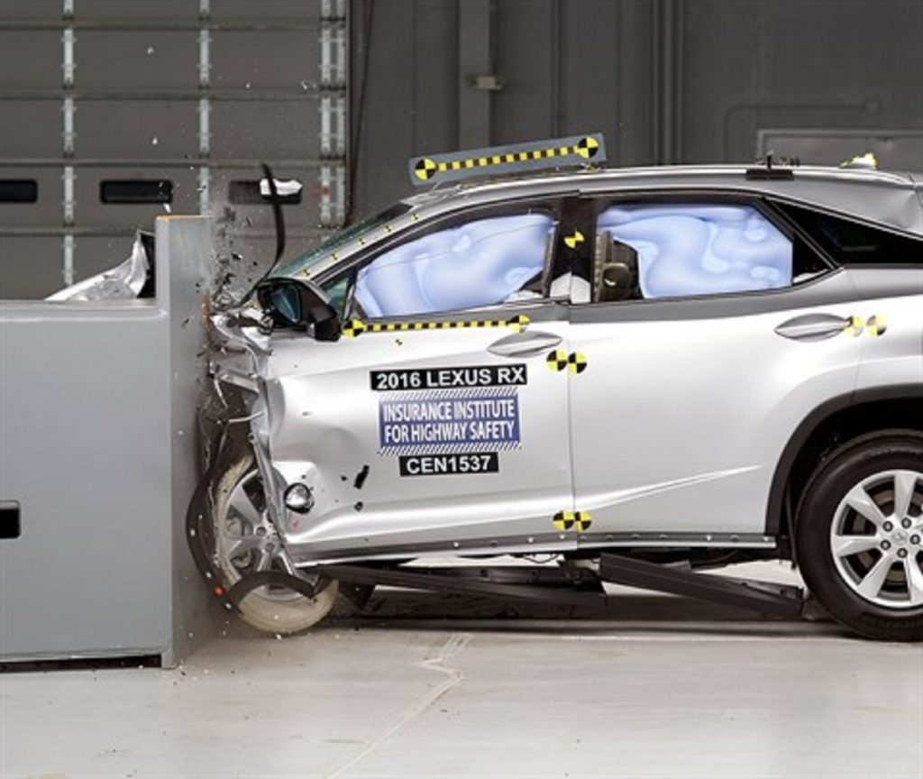 A silver Lexus RX is being crash tested.