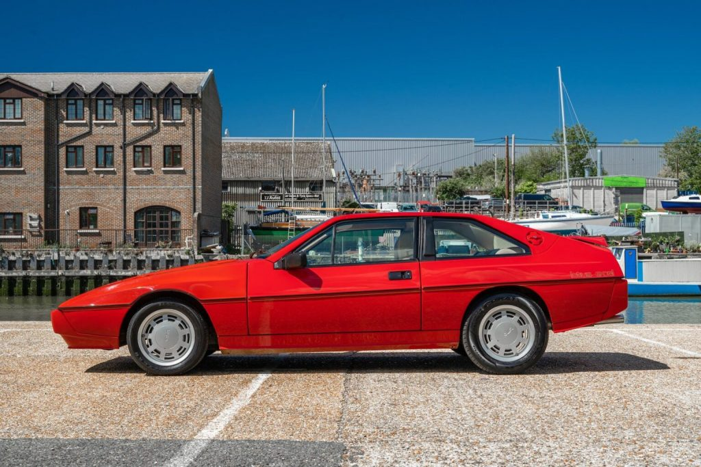 a red Lotus Excel from 1984. These are an obscure vintage European sports car