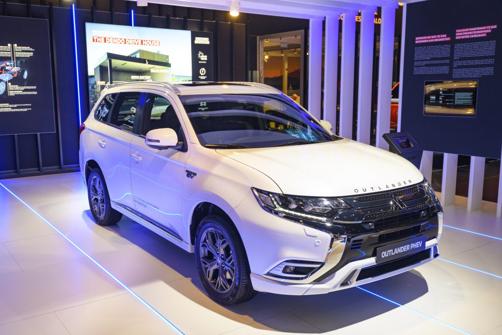 White Mitsubishi Outlander PHEV crossover plug-in hybrid SUV on display at Brussels Expo